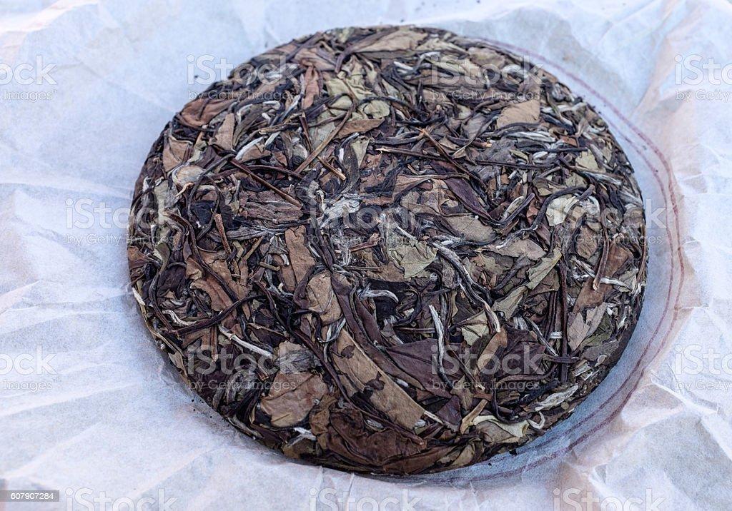 chinese shou mei pressed tea cake. stock photo