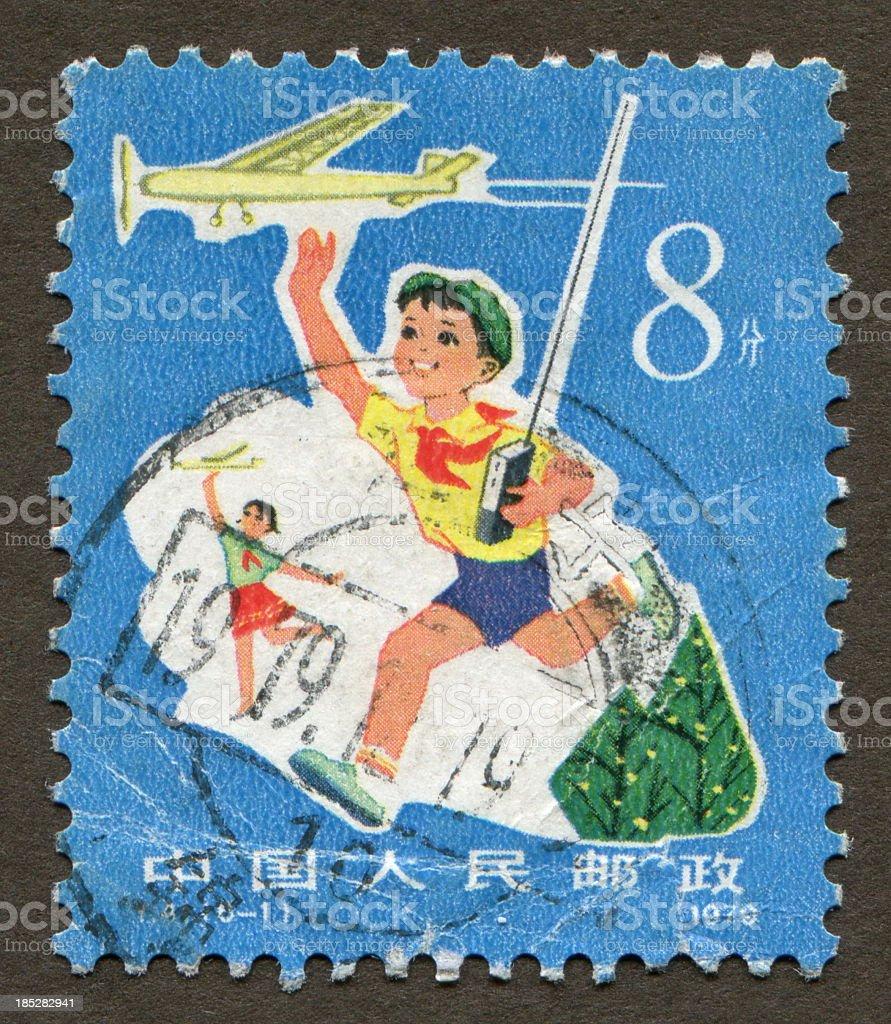 Chinese stamp:China boy play stock photo