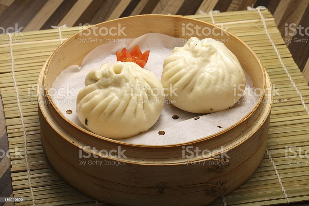 Chinese steamed bun filled with pork and vegetables stock photo