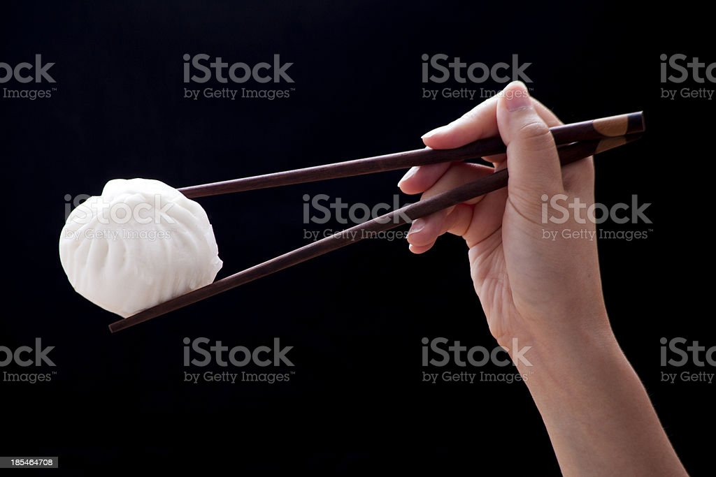 Chinese steamed bun with chopsticks (Dim Sum) royalty-free stock photo