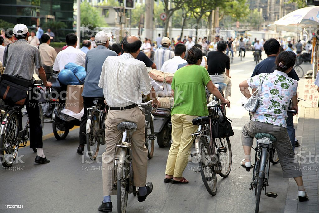 Chinese street with many bikers royalty-free stock photo