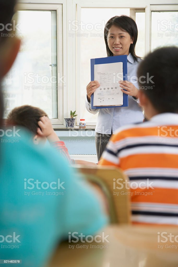 Chinese student in classroom at school stock photo