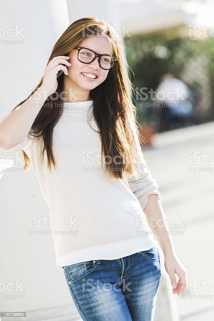 Chinese student using smartphone royalty-free stock photo