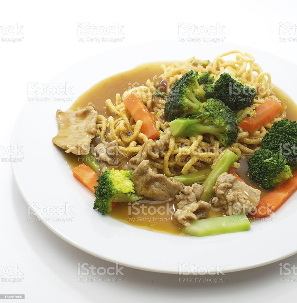Chinese style deep fried yellow noodles with pork and soup royalty-free stock photo