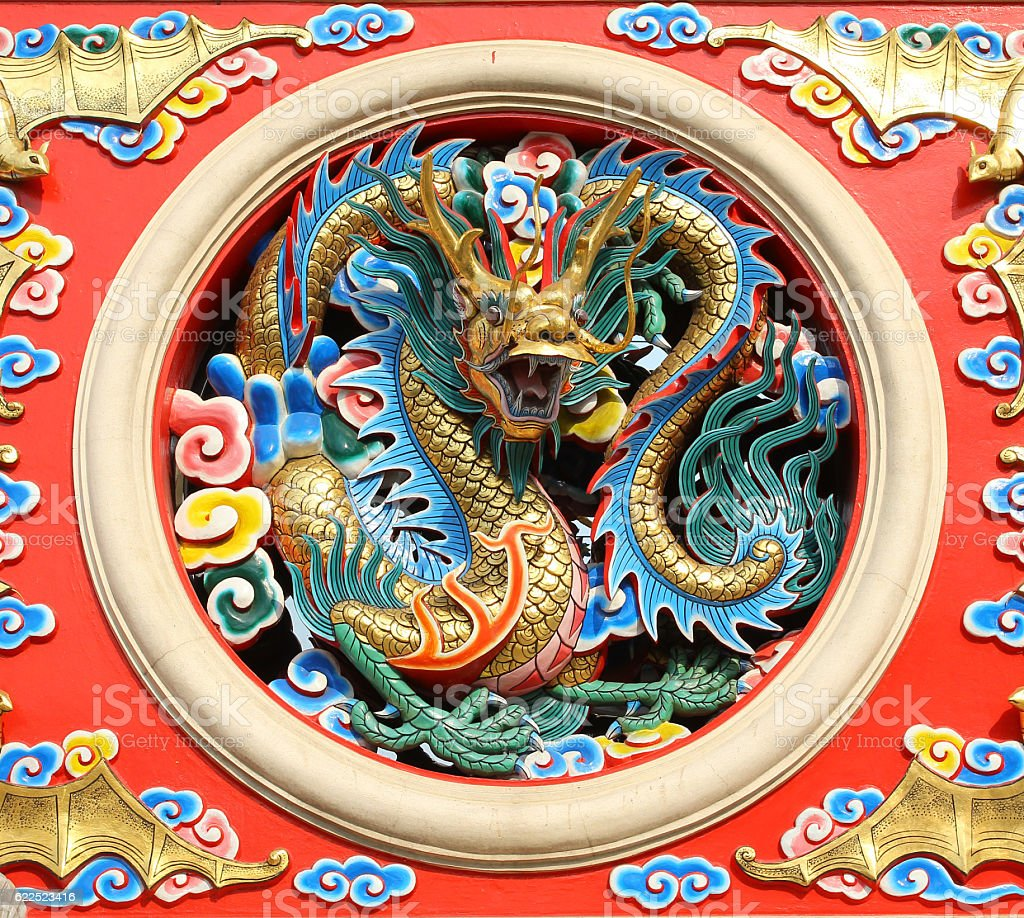 Chinese style dragon sculptures on the temple walls stock photo