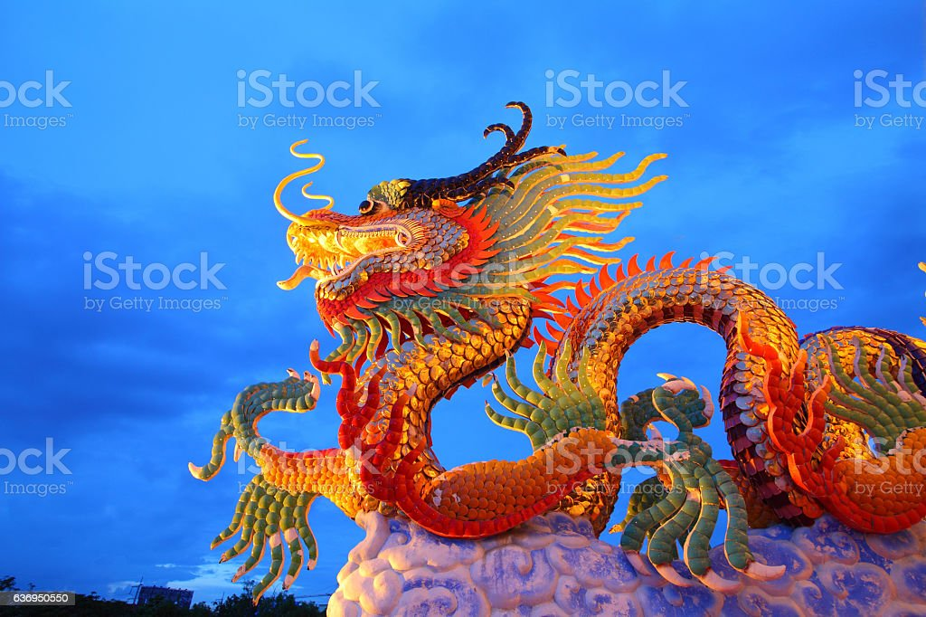 Chinese style golden dragon statue,shinning in beautiful twiligh stock photo