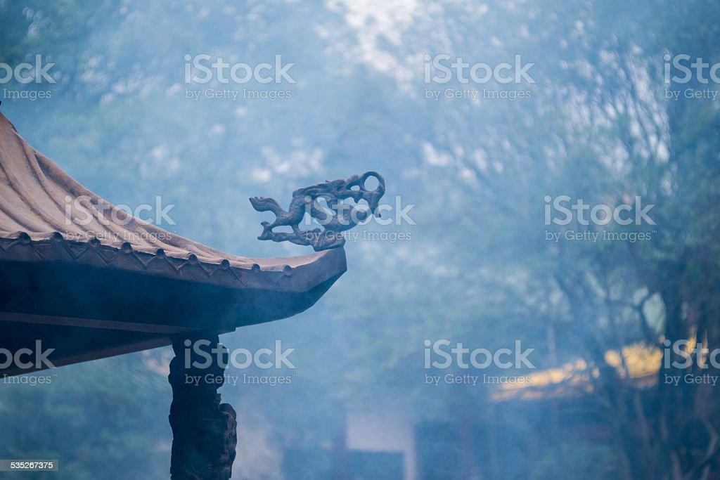 chinese style statue on the roof stock photo
