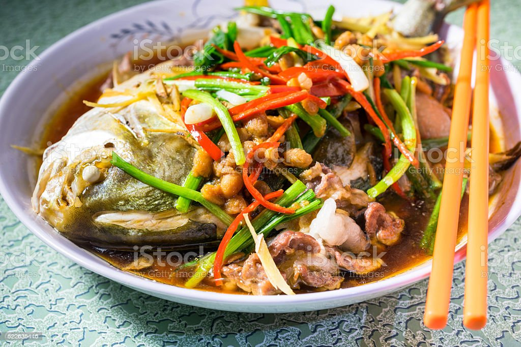 Chinese style stream boiled fish stock photo
