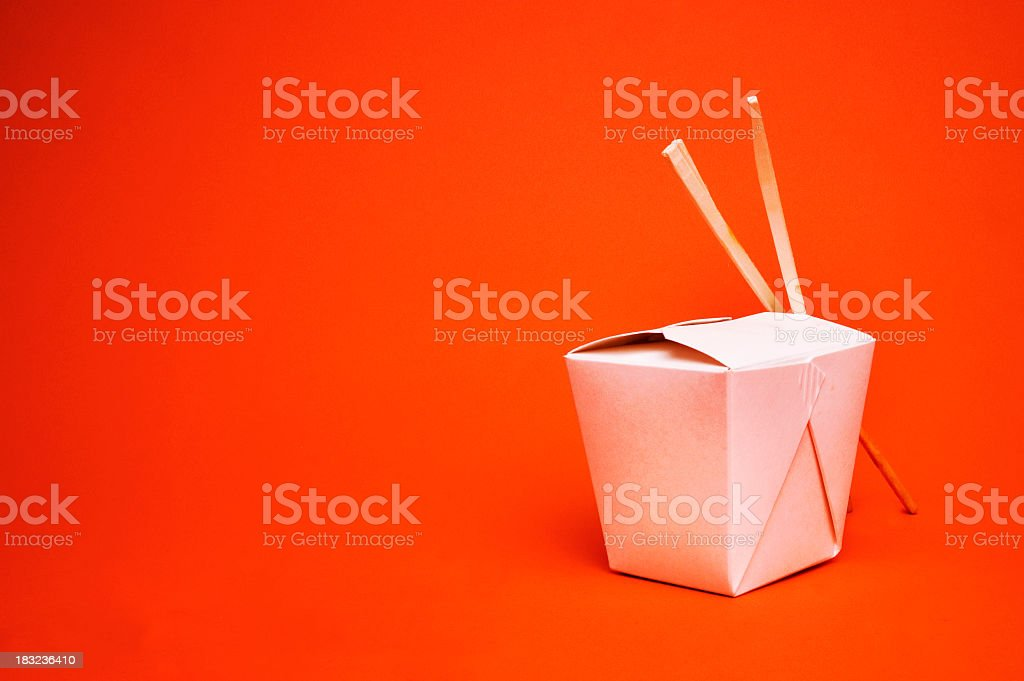 Chinese takeout container with chopsticks, isolated on red stock photo