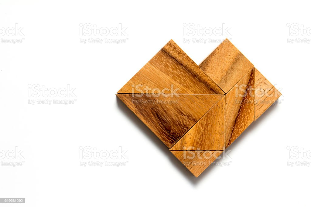 Chinese tangram puzzle in heart shape on white background stock photo