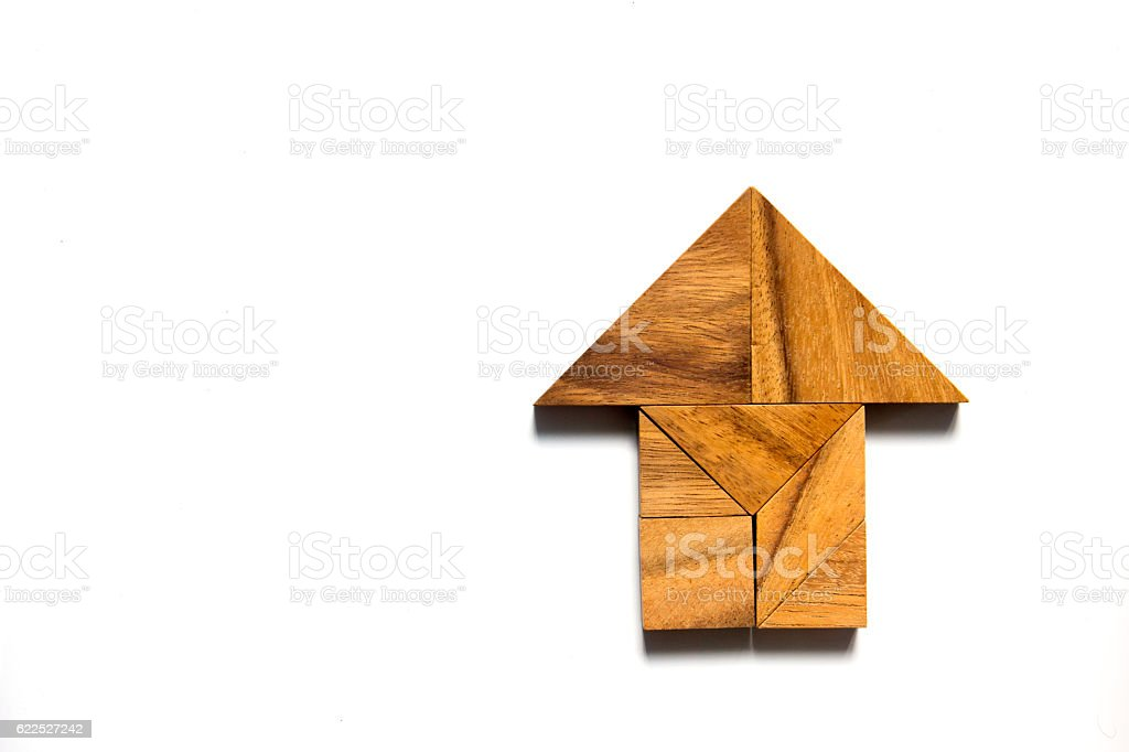 Chinese tangram puzzle in home shape on white background stock photo