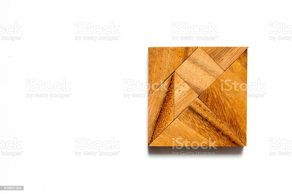 Chinese tangram puzzle in square shape on white background stock photo