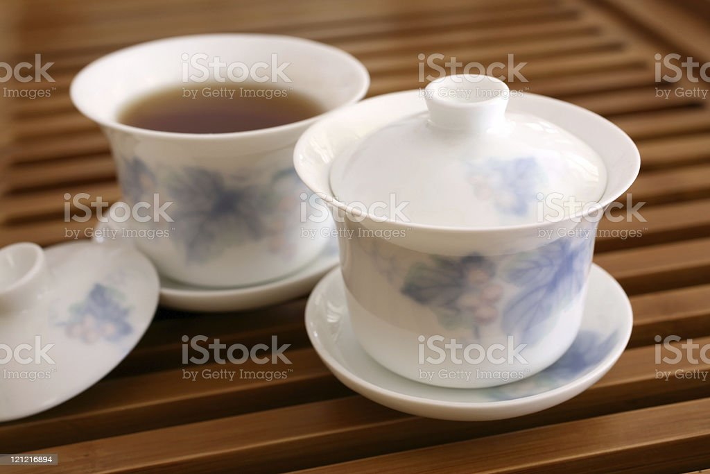 Chinese Tea Cups on Wooden Rack royalty-free stock photo