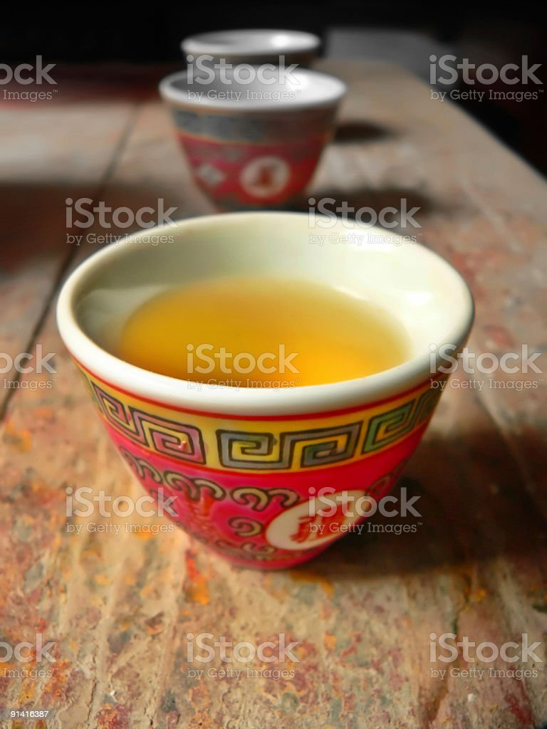 Chinese Tea cups with nice patterns on a wooden bench royalty-free stock photo