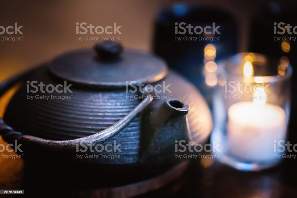 Chinese tea in cast iron kettle stock photo