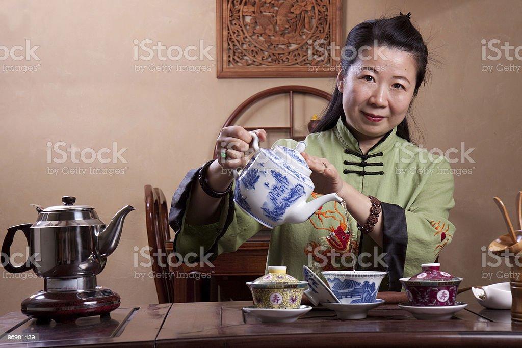 Chinese tea master making a fresh pot royalty-free stock photo