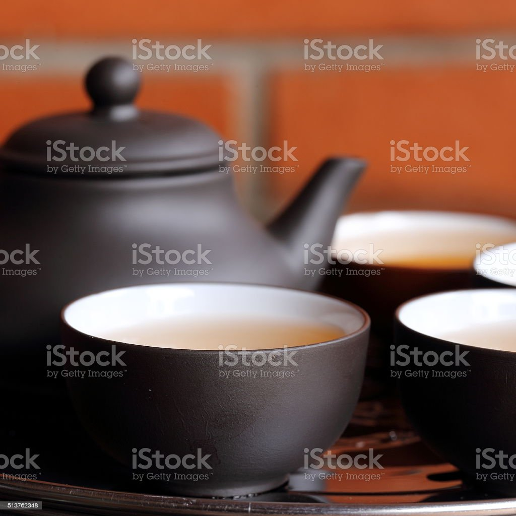 Chinese Tea Pot and Cups on Table stock photo