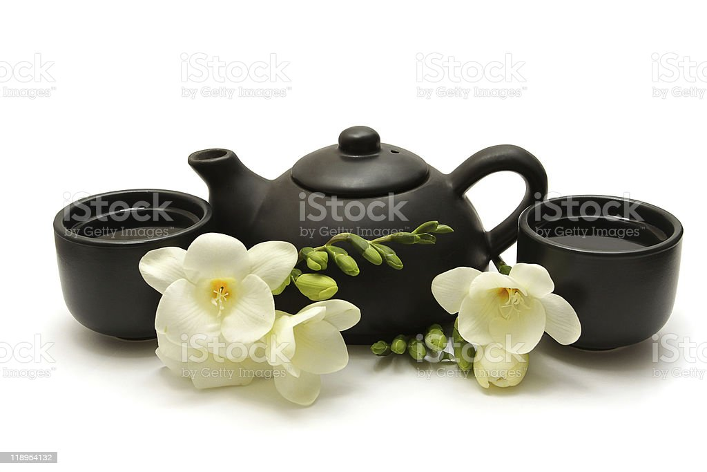 Chinese tea set with teapot, cups and white flowers royalty-free stock photo