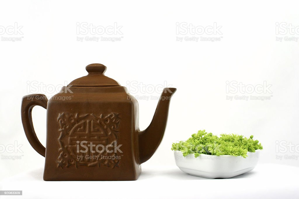 Chinese teapot and fresh green stock photo