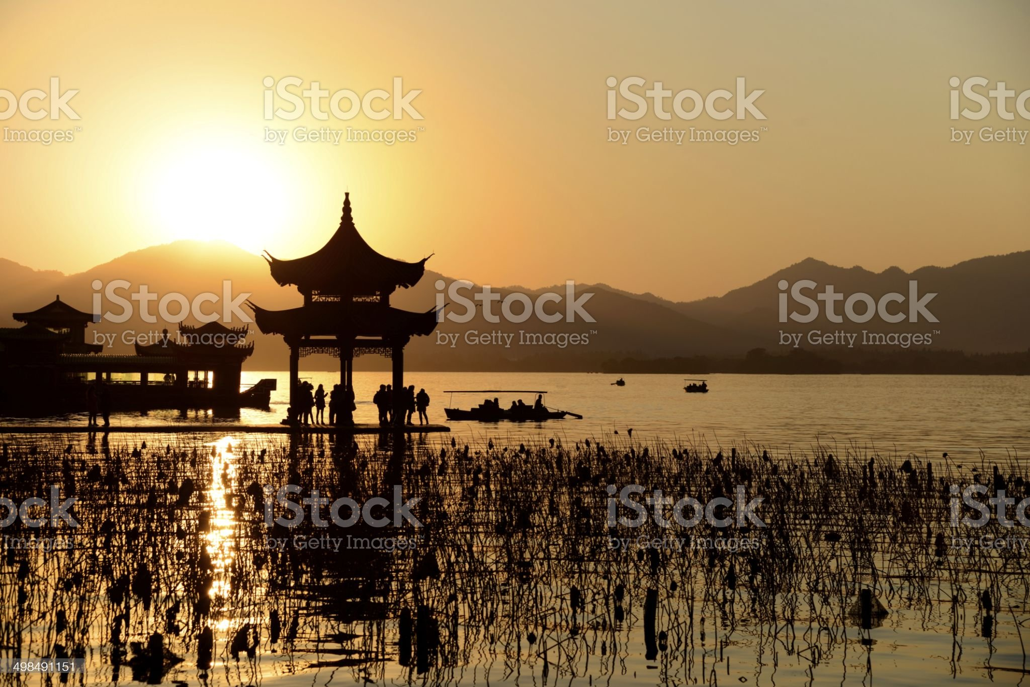 Chinese temple in west lake with sunset royalty-free stock photo