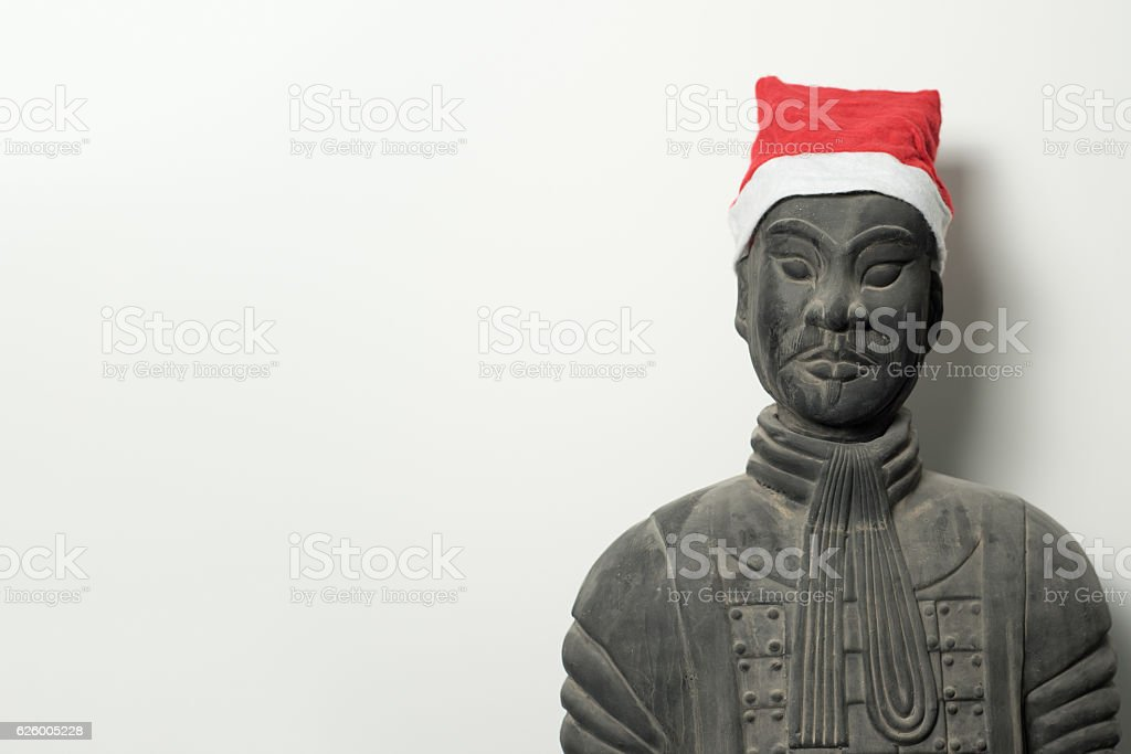 Chinese terracotta warrior statue with santa hat stock photo