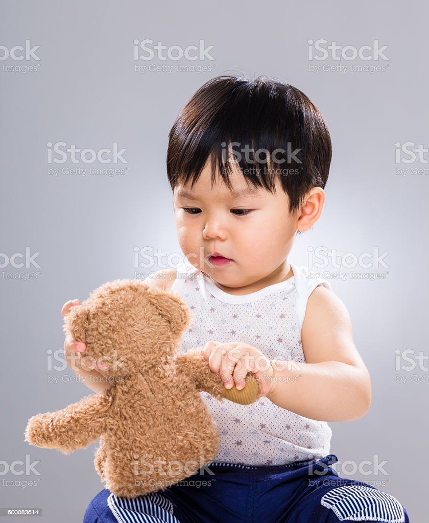 Chinese toddler with stuffed toy stock photo