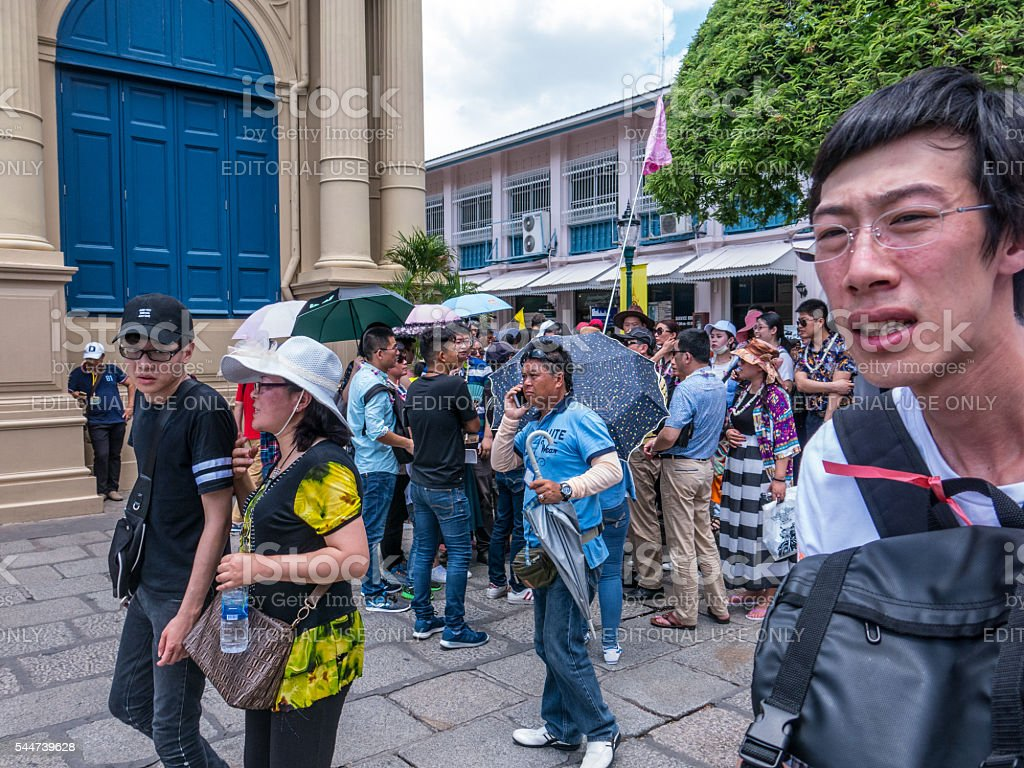 Chinese Tourist Group with Phones and Flags stock photo