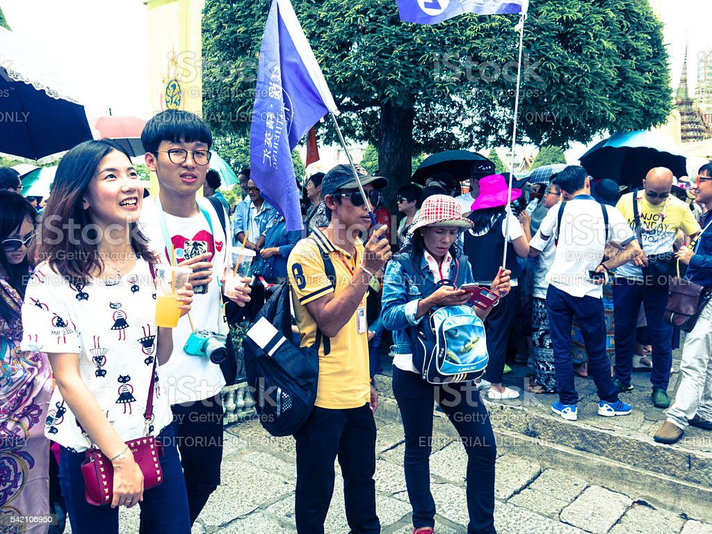 Chinese Tourist Group with Selfie Flags stock photo