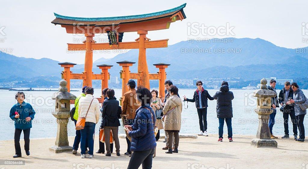 Chinese tourists at Miyajima Torii stock photo