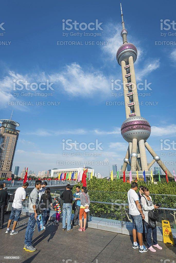 Chinese tourists below Oriental Pearl Tower iconic landmark Shanghai China royalty-free stock photo