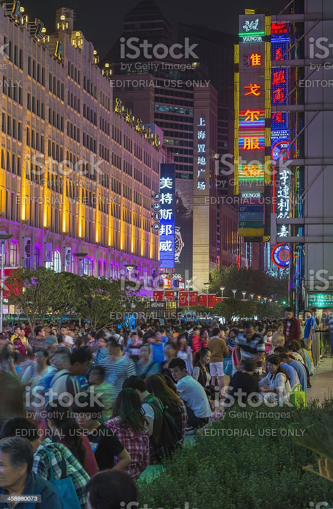 Chinese tourists crowding Nanjing Road neon night shops Shanghai royalty-free stock photo