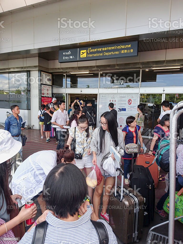 Chinese tourists prepare to depart at Chiang Mai International Airport. stock photo