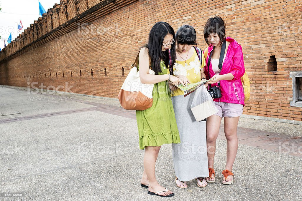 Chinese Tourists With Map stock photo