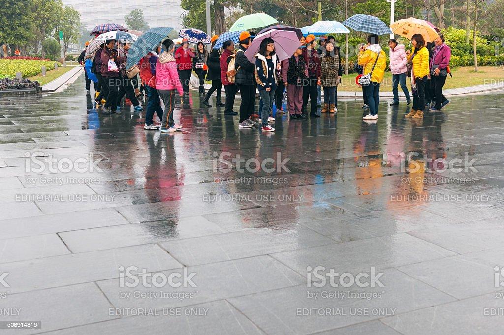 Chinese Tourists with Umbrellas in Guangzhou,park, Guangzhou, China stock photo