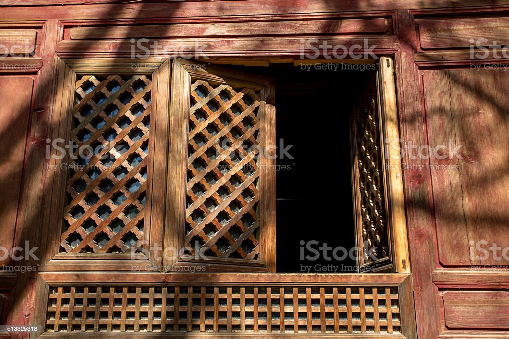 Chinese traditional carved wooden window stock photo