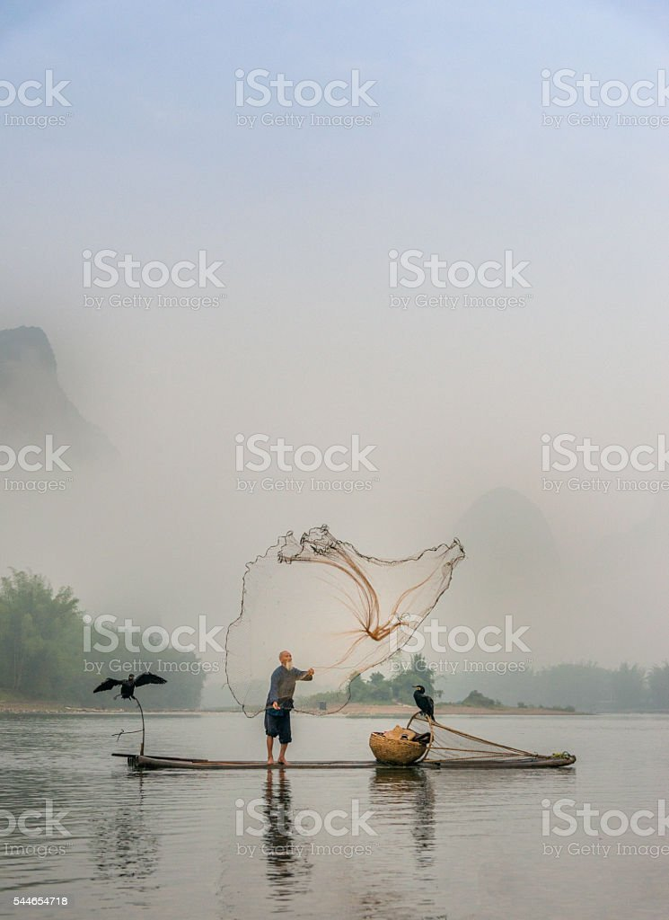 Chinese traditional fisherman with cormorants fishing, Li River China stock photo