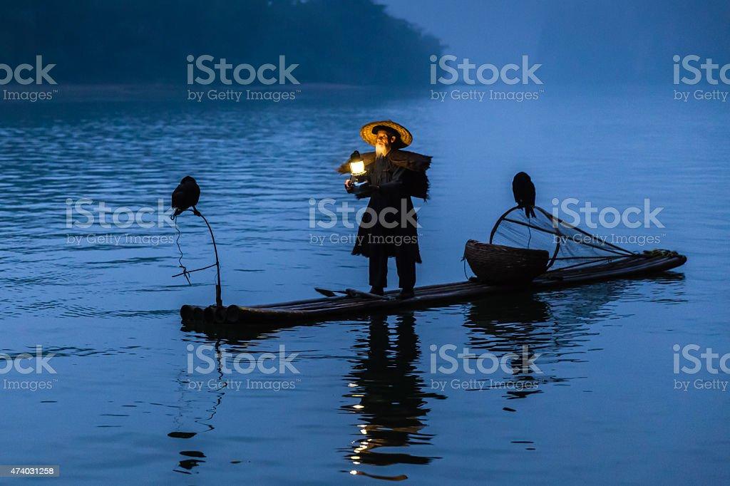 Chinese traditional fisherman with raft fishing on Li River China stock photo