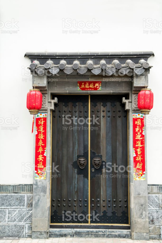 Chinese traditional gate decorated with spring couplet stock photo