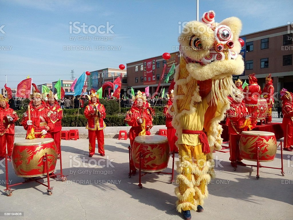 Chinese traditional lion dance with drummers stock photo