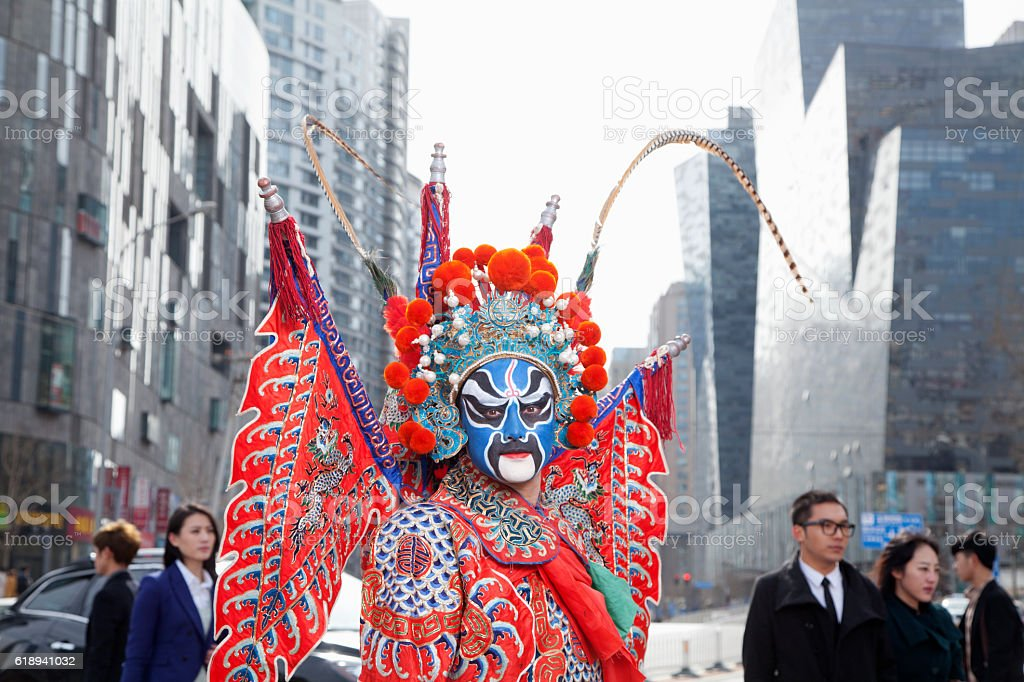 Chinese traditional opera singer crossing street in city stock photo