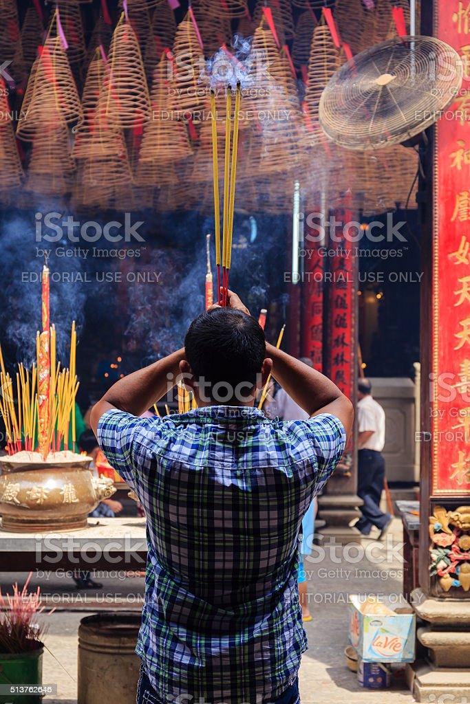 Chinese Vietnamese Praying in Temple stock photo