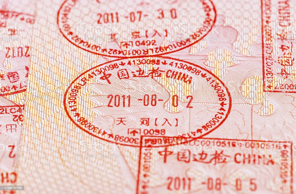 Chinese Visa entry and exit stamps in passport stock photo
