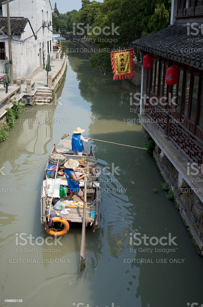 Chinese waste collectors working from boat in water city stock photo