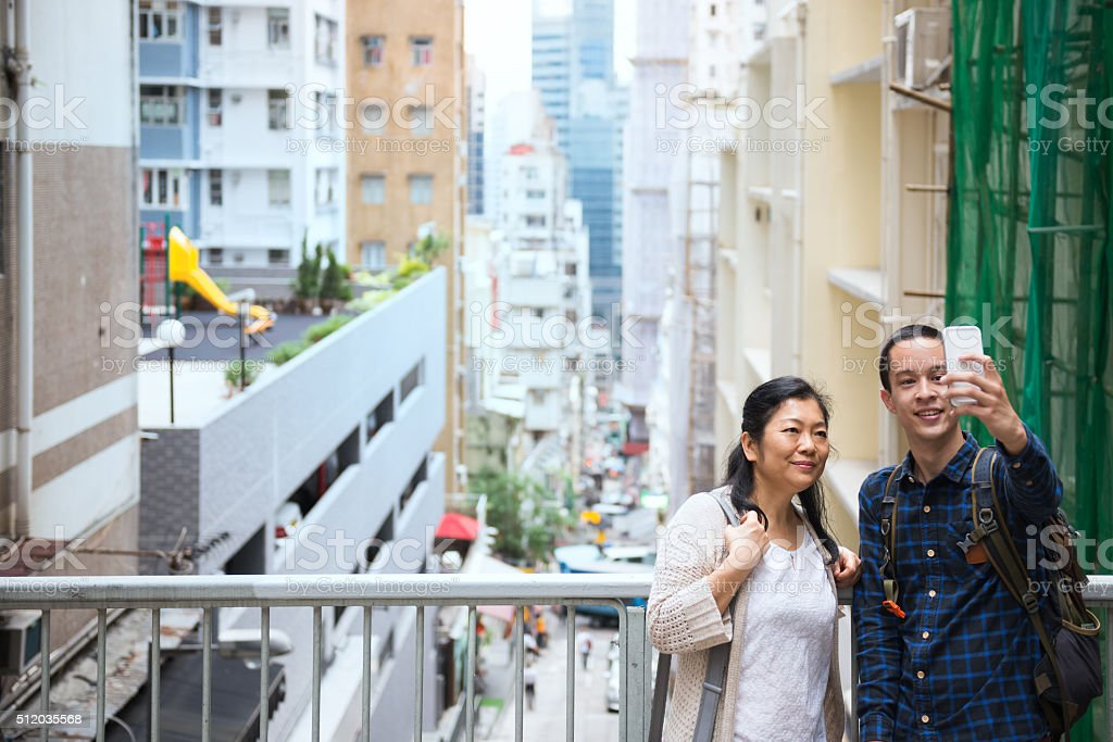 Chinese Woman and Man Taking Selfie, Mid-Levels Neighbourhood, Hong Kong stock photo