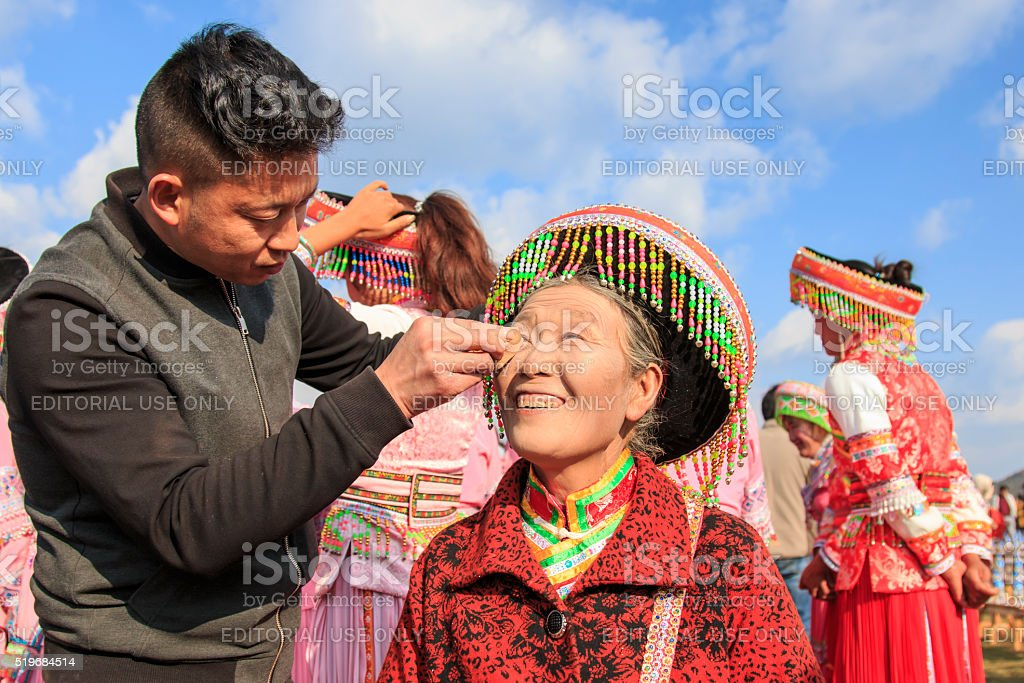 Chinese woman getting ready for the Heqing festival stock photo