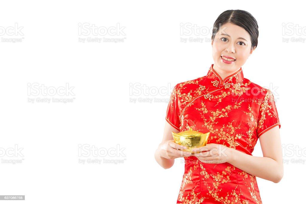 chinese woman holding golden ingot stock photo