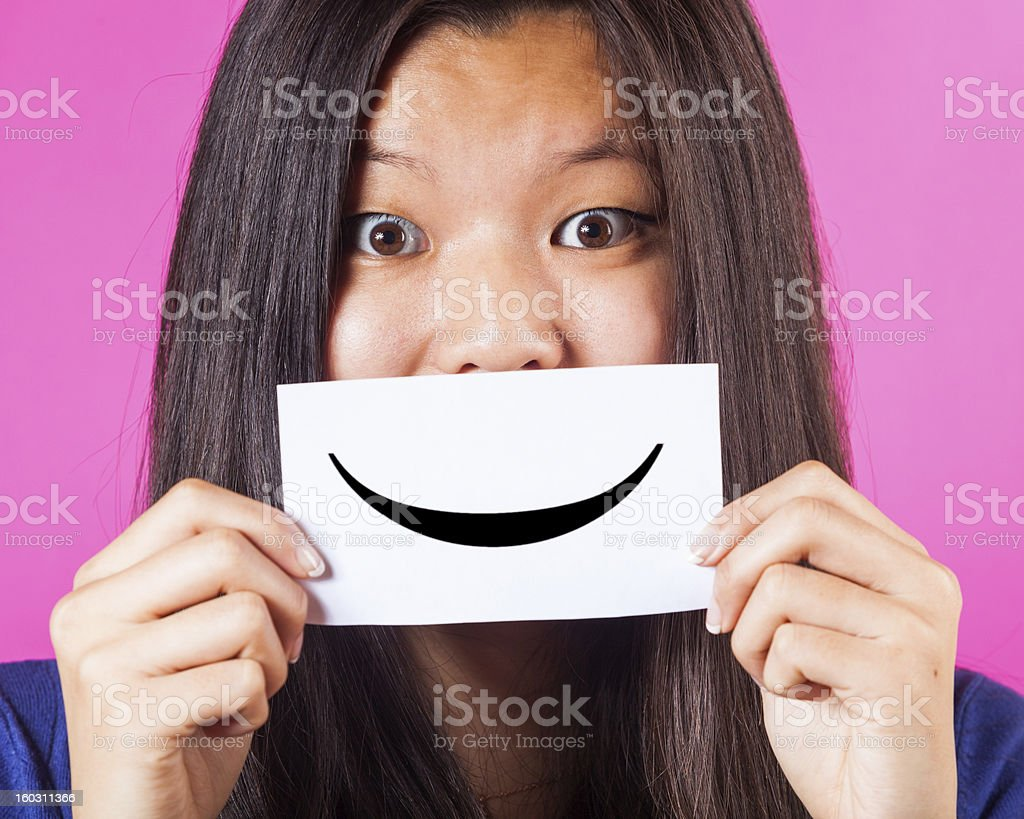 Chinese Woman Holding Smiling Emoticon royalty-free stock photo