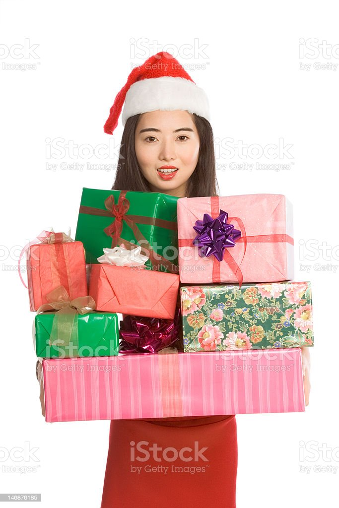 Chinese woman holding stack of Christmas presents royalty-free stock photo