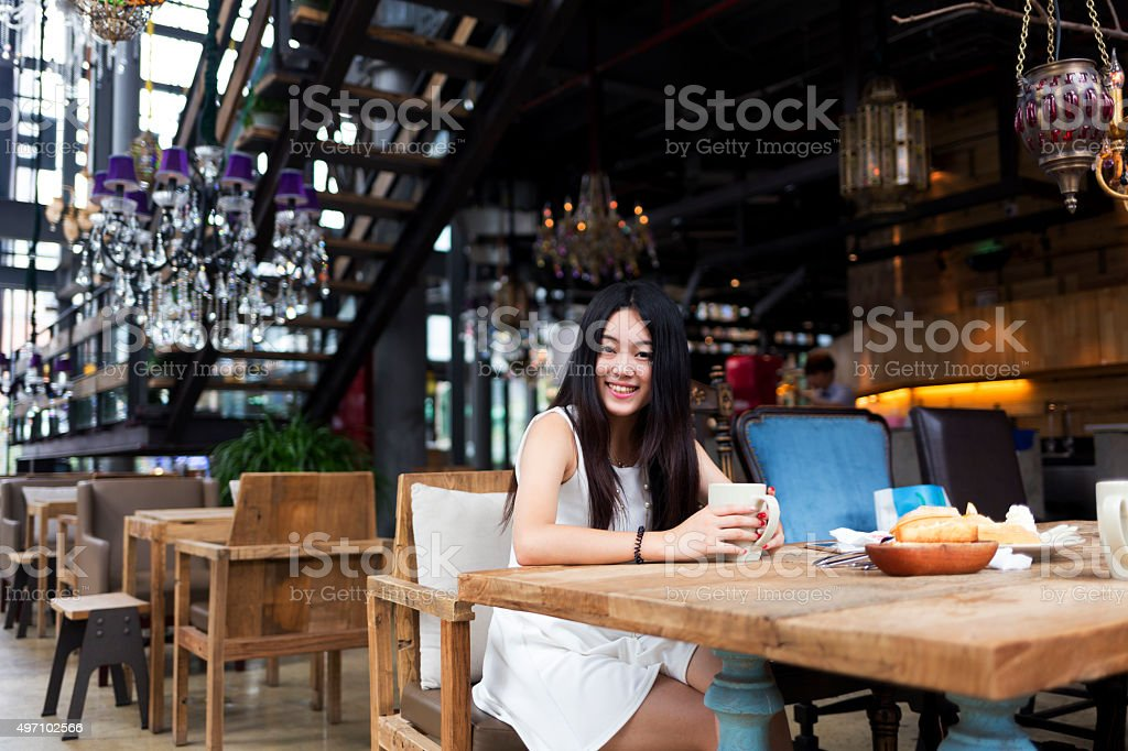 Chinese woman in a restaurant stock photo