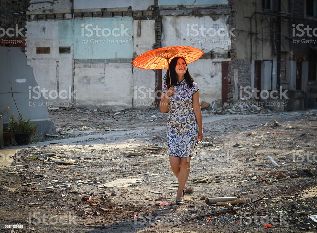 Chinese woman in abandoned sitee stock photo